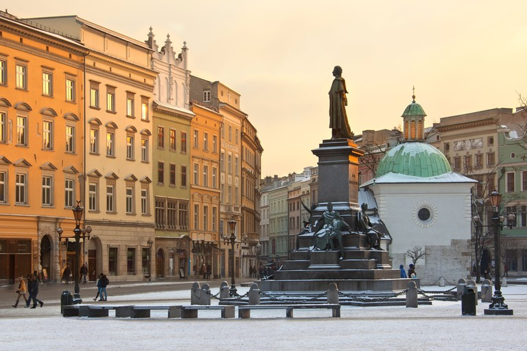 Winter sun on the buildings in the Market Square (Rynek Glowny) Krakow in Poland