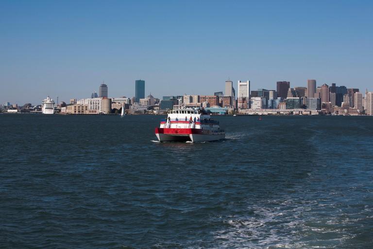 Tourist tour boats sailing across Boston Harbor