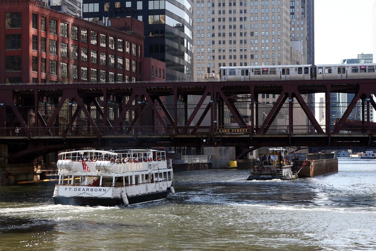 An architecture cruise ship and barge on the Chicago River