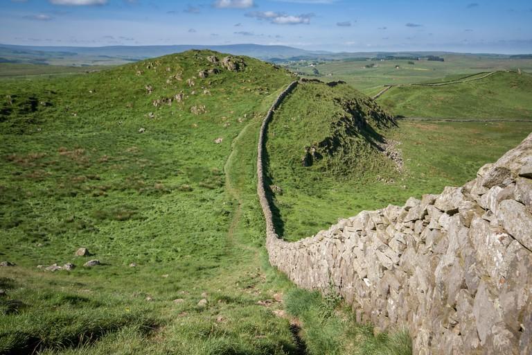 Hadrians Wall snaking across rolling hills