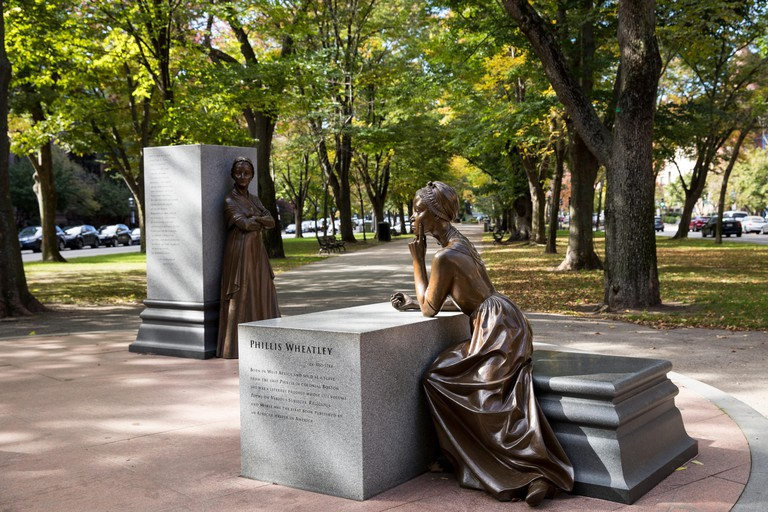 Statue of Phillis Wheatley, sold as a slave, is part of Boston Women's Memorial in Commonwealth Avenue Mall