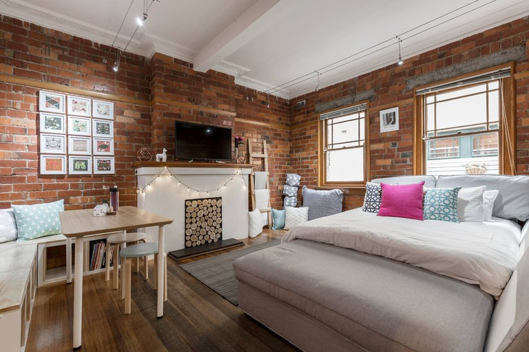 Perfectly positioned exposed red-brick apartment