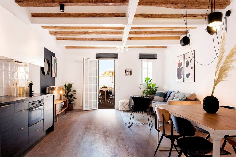 The flat features a simple, chic design and is just a block away from the Sagrada Família