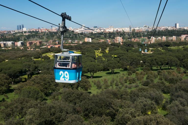 Many people choose to enter the Casa de Campo via Madrid's cable car, the Teleférico