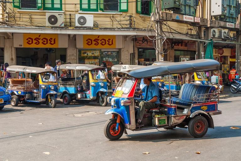 Tuk Tuk taxis on street in Bangkok, Thailand.