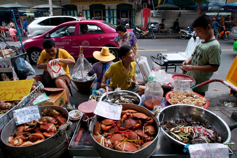 Enjoy a seafood snack as you shop for an amulet