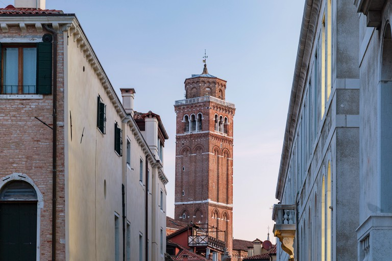 Dawn in sestiere of San Polo, Venice, Italy. Basilica dei Frari tower in the distance.