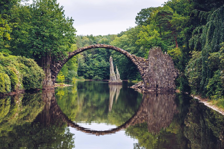 Rakotz bridge (Rakotzbrucke) also known as Devil's Bridge in Kromlau, Germany. Reflection of the bridge in the water create a full circle.
