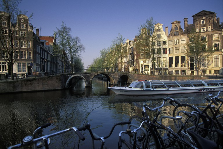 Tour boat along the Herengracht canal in Amsterdam