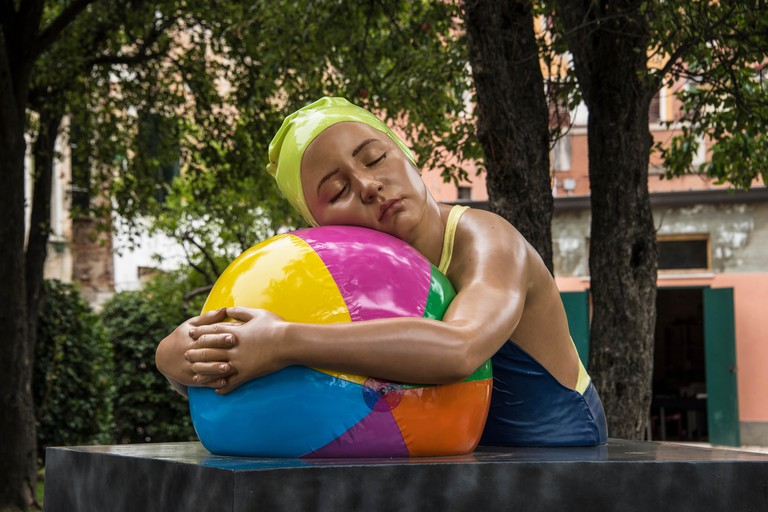 Monumental Brooke with Beach Ball, a hyper-realistic sculpture by Carole A Feuerman on show at the Venice Biennial open air exhibition in Venice, 2017