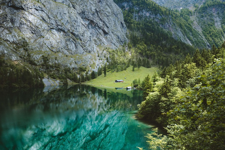 Scenic Lake Obersee on a beautiful day with blue sky and clouds in summer, Berchtesgadener Land. Upper Bavaria, Germany
