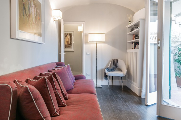 The interiors of this apartment on Via de' Tornabuoni, Florence, are full of light