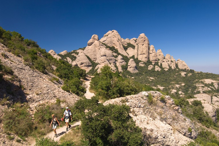 People hiking in Montserrat mountains