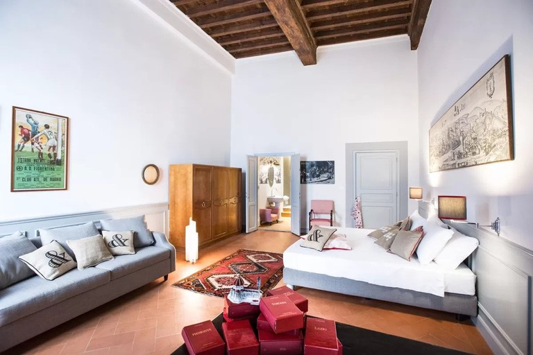 Fashionable furnishings are accessorised with a mixture of vintage pieces at SoprArno Suites