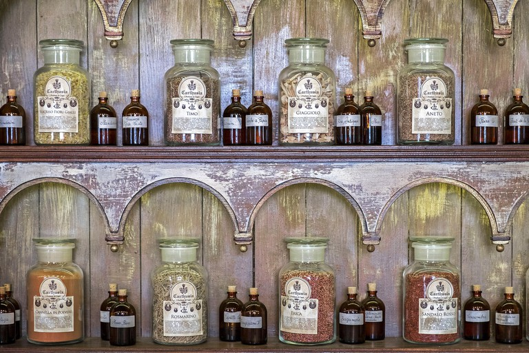 Antique bottles and jars of perfume ingredients at the Carthusia perfumery on the island of Capri, Italy