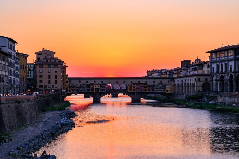 Sunset at Ponte Vecchio over the river Arno in Florence