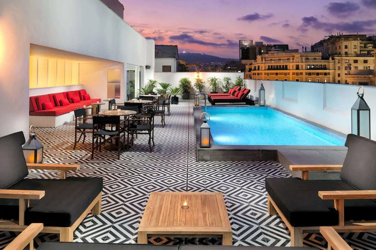 A rooftop pool, vertical garden and hovering fireplace make H10 Metropolitan a trendy spot to stay