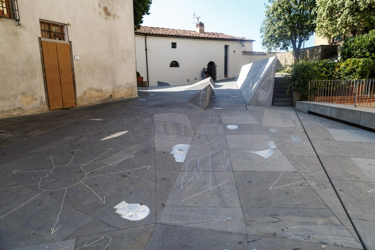 View of the shapes and signs in Piazza Dei Guidi, a small square at vinci village, in front of Leonardo Da Vinci Museum in Italy