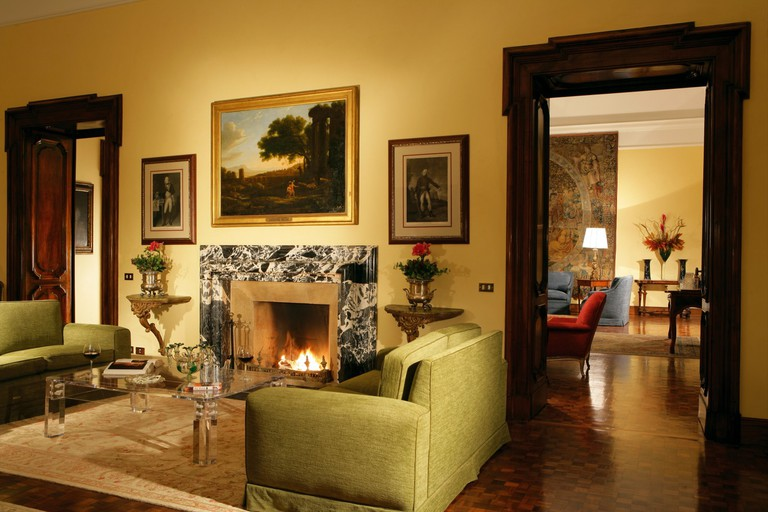 Elegant staircases and marble fireplaces offer a cosy backdrop to the beautiful antique furniture and tapestries.