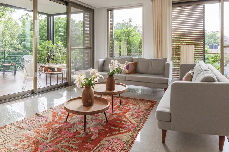 The sleek, modern apartments each have a balcony