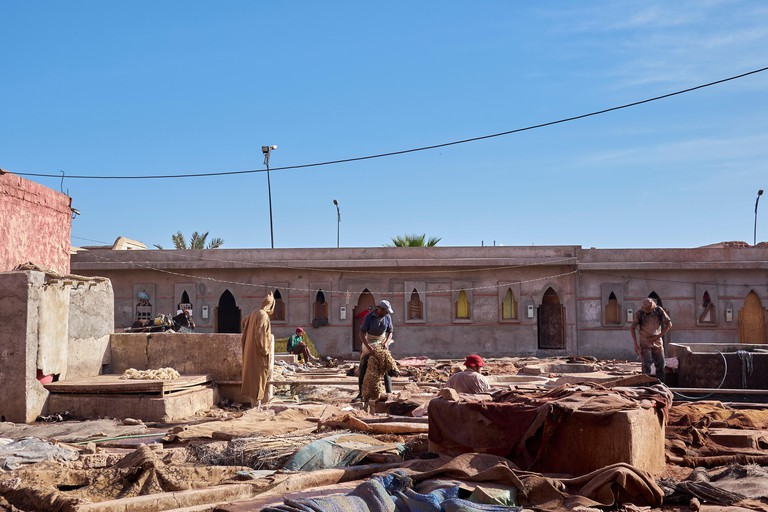 Men working at the Tanneries in the Medina district, Marrakech.