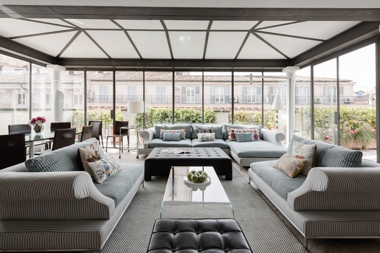 The living room opens onto a panoramic terrace with spectacular views