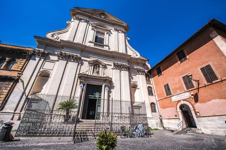 Piazza della Scala, with the face of the Church of Santa Maria della Scala at left and the old Pharmacy Santa Maria della Scala at right, in Trastevere quarter, Rome, Italy