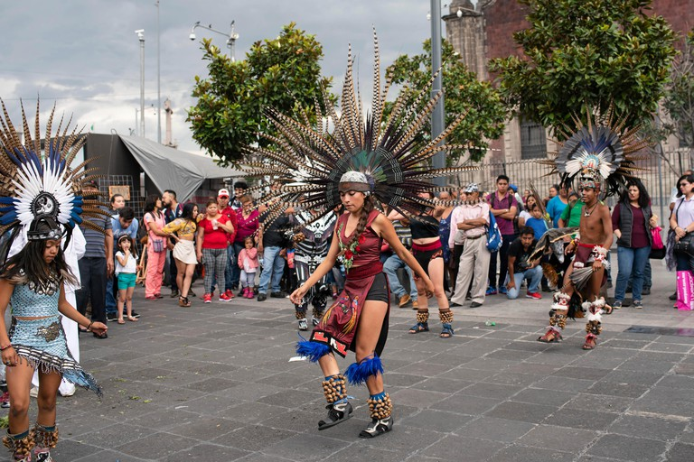Aztec dancers (concheros) performing ritual dance at the Zocalo, Mexico City, CDMX, Mexico. Jun 2019