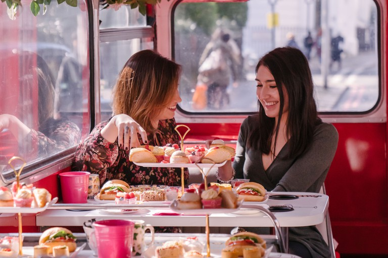 Book an afternoon tea bus tour for an indulgent way to see the city