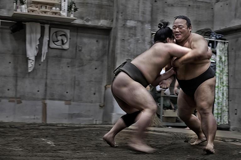 Japanese sumo wrestler training in their stall