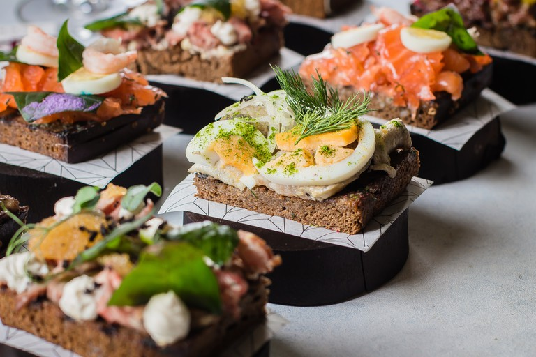 Smorrebrod. Traditional Danish open sandwiches, dark rye bread with different topping