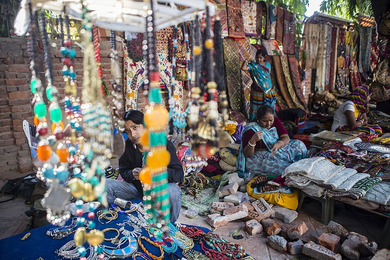 Vendors wait for customers at their handicraft stalls in the Janpath Market.