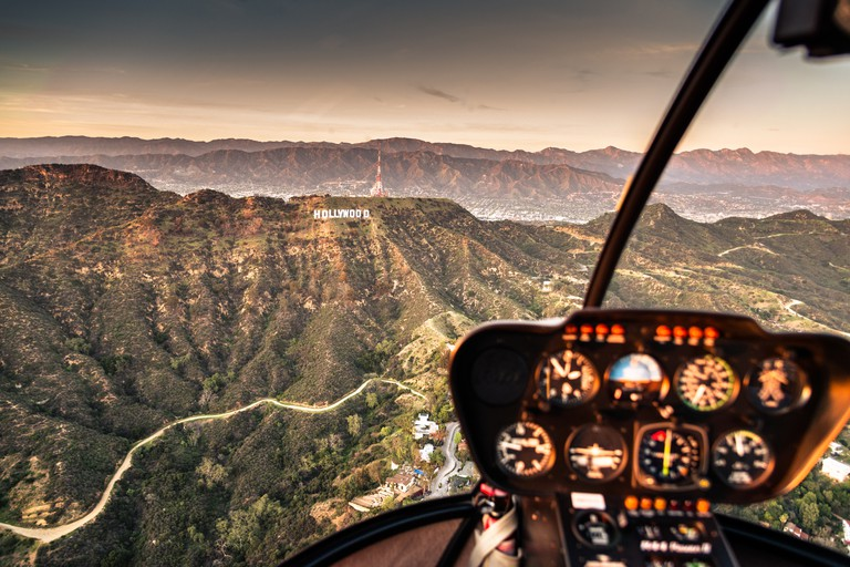 Aerial view of the Hollywood sign at dusk in Los Angeles.
