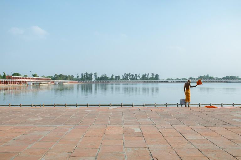 An Indian sadhu prepares to take a bath in one of Kurukshetra's holy tanks