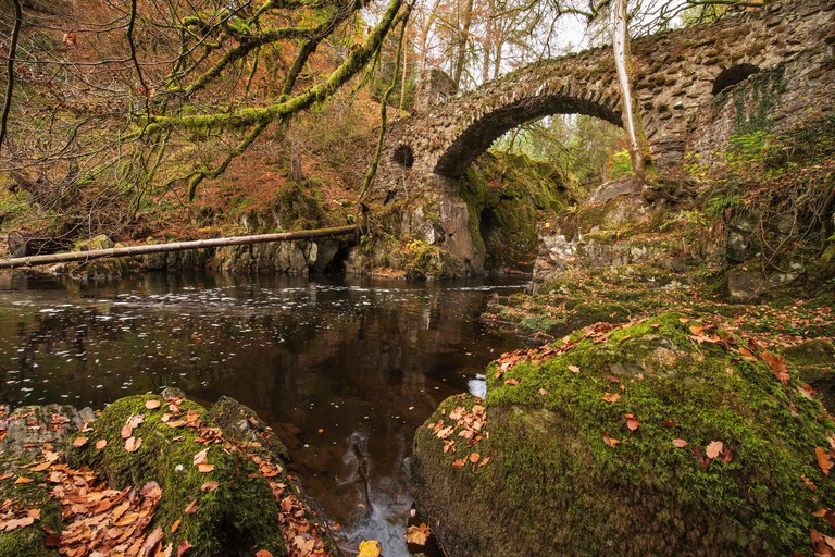 The river Braan flowing under the stone bridge at he Hermitage near Dunkeld, Perthshire, Scotland.
