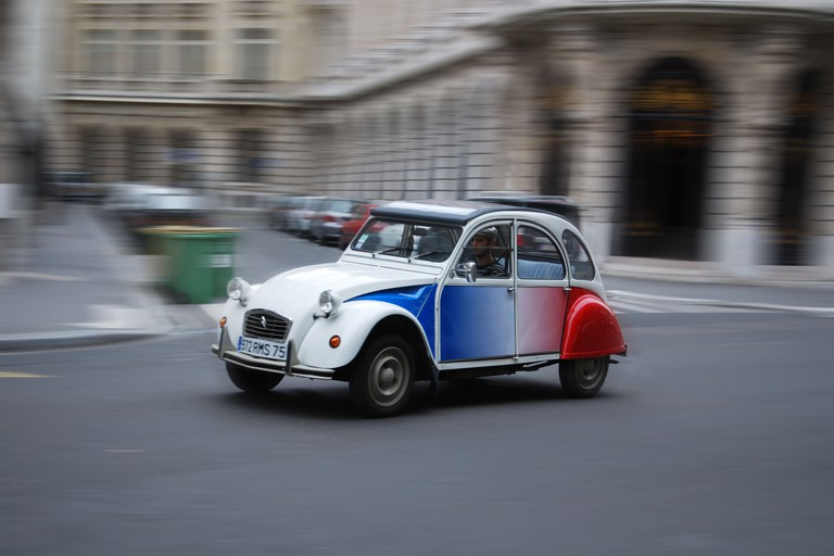 Take a tour of Paris in a classic Citroen 2CV.