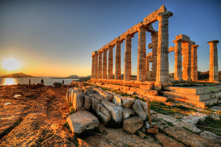 The sun setting at Cape Sounion over the Temple of Poseidon