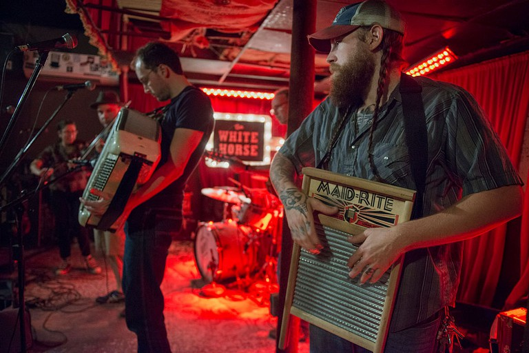 Austin Texas See musicians play a washboard at The White Horse bar in Austin