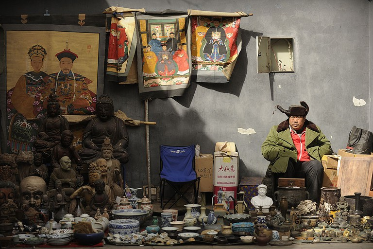 A vendor waits for customers at Panjiayu