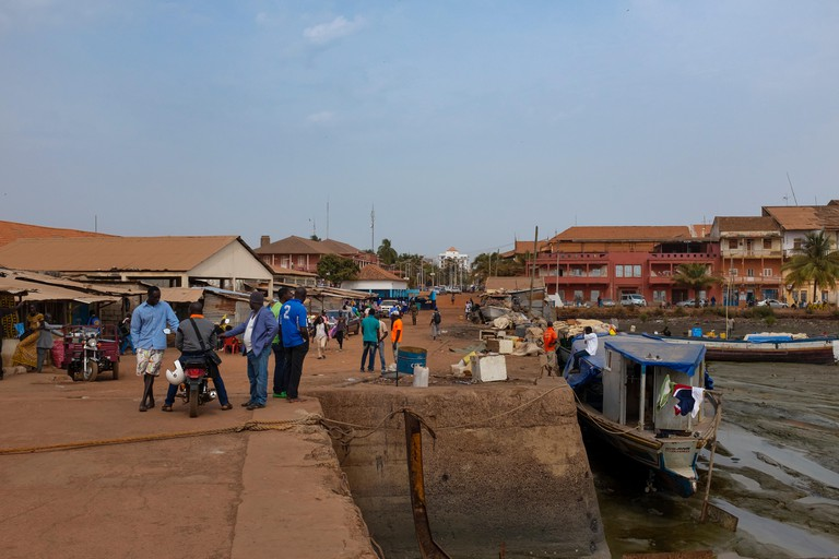 People at the Port of Bissau in the city of Bissau, in Guinea-Bissau.