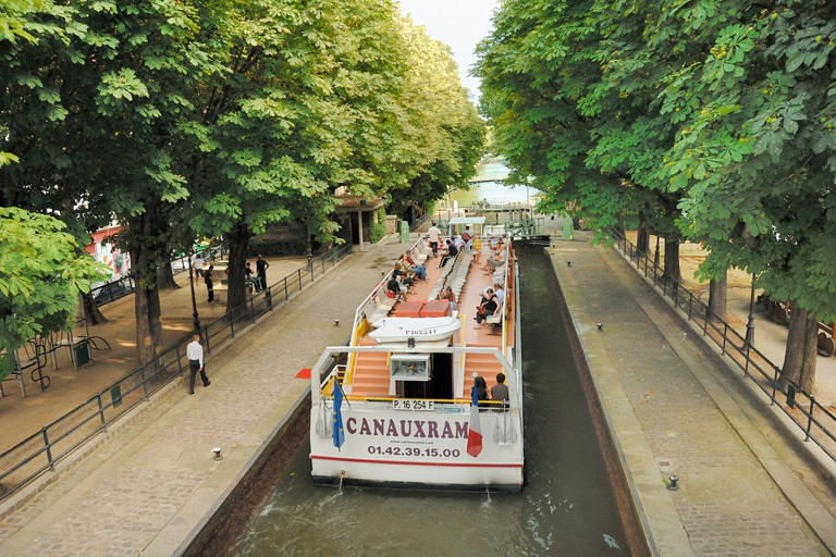 Float down the Canal Saint-Martin.