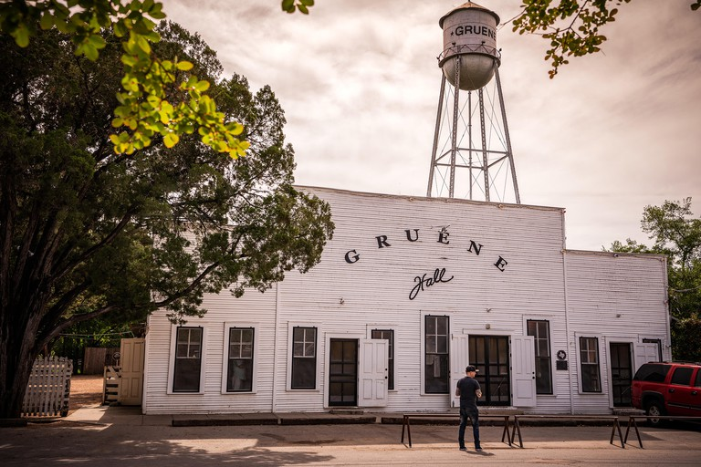 Famous western dance hall in Gruene Texas with water tower in background.