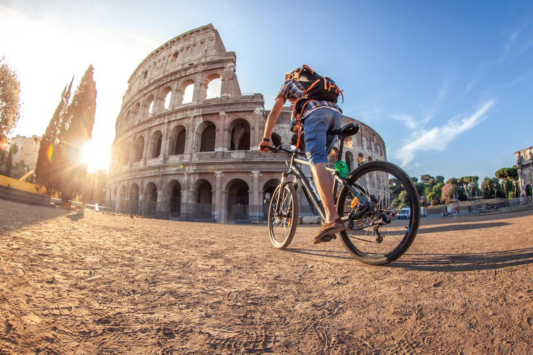 Tourist colosseum in Rome, Italy at sunrise.