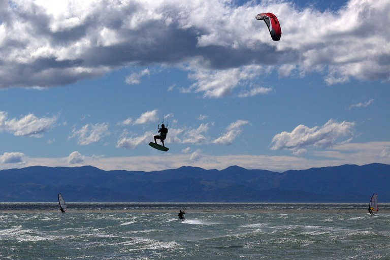 Kitesurfers in action at Tahunanui Beach