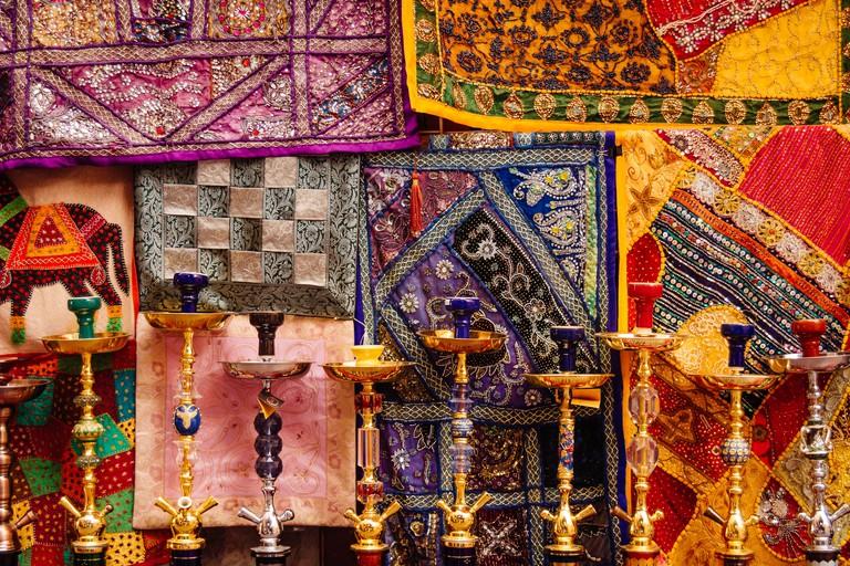 Colorful rugs and hookahs for sale at Bur Dubai Souk