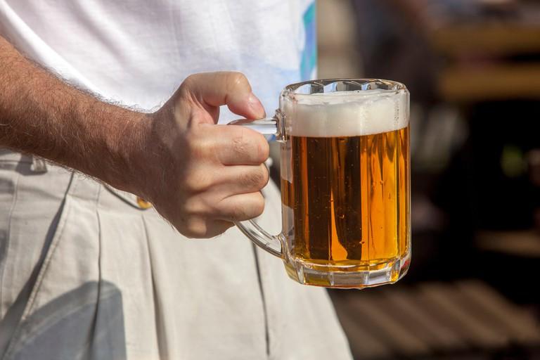 Freshly tapped Prague beer glass Czech Republic