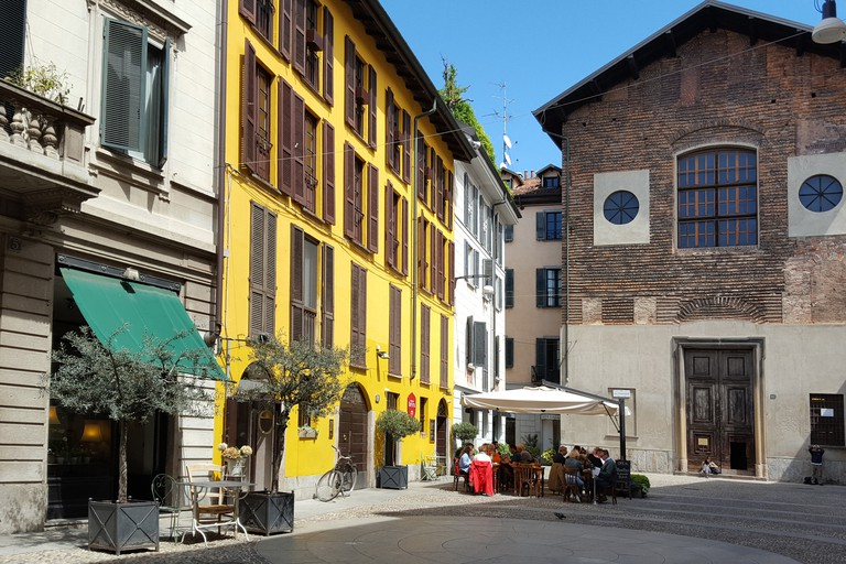 Little square with the medieval Chiesa di San Carpoforo in the Brera district in Milan, Italy