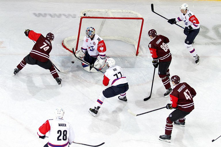 Support a local hockey teams at a Champions Hockey League match