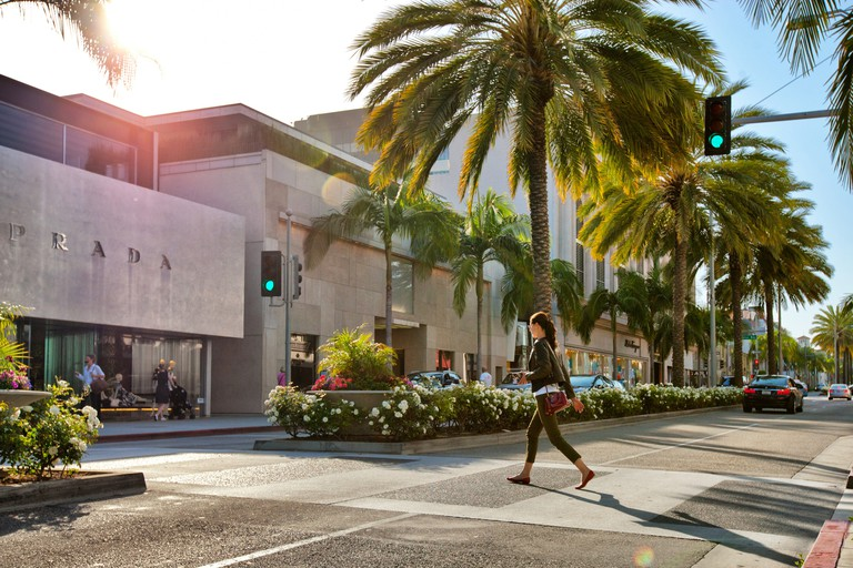 Woman crossing Rodeo Drive