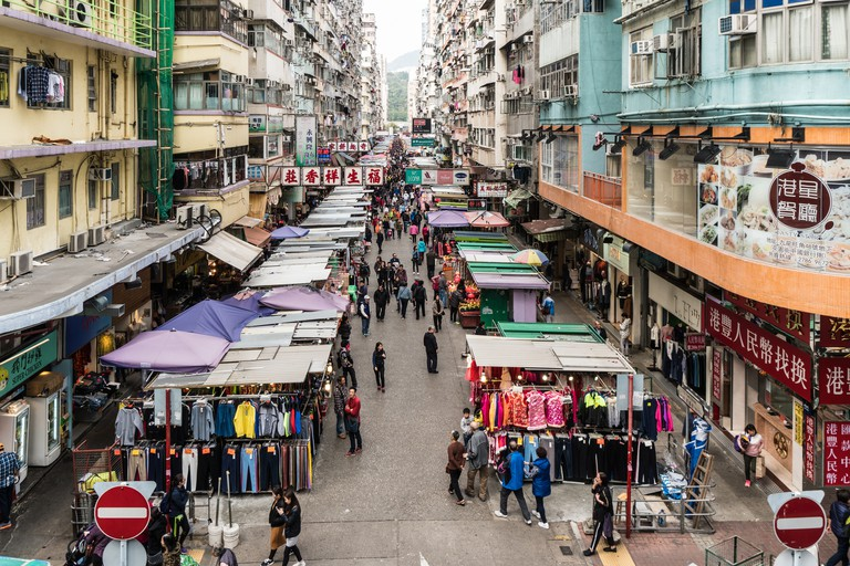Street market in the crowded streets of Mong Kok in Kowloon in Hong Kong